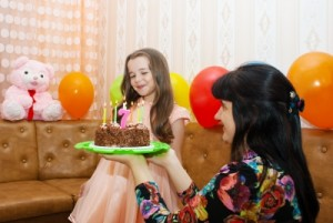 girl getting birthday cake
